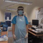Carers in health care uniforms wearing Protective clothing and masks during the covid-19 epidemic