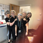 Carers in dark uniforms wearing Protective masks during the covid-19 epidemic